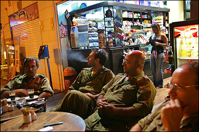 Israeli Army reservists relaxed yesterday at a coffee shop in the town of Nahariya as they prepared to be demobilized.