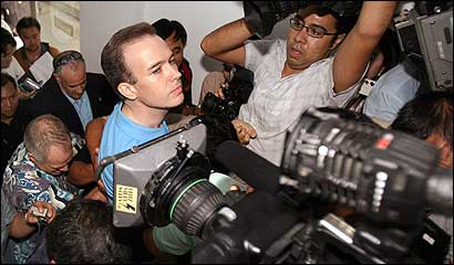 John Mark Karr, the suspect, was ushered through a crowd of media yesterday at the immigration department in Bangkok.