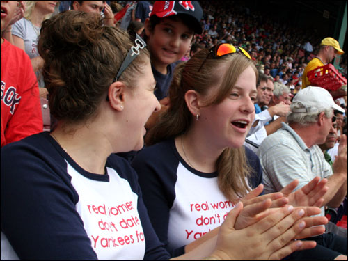 Michal Fuld and Tamar Kram from Brookline cheered as David Ortiz beats out an infield hit.