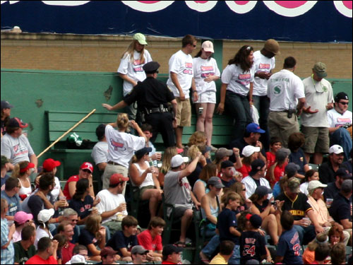 There was a roar in the bleachers when the police officer tossed the broom aside ...
