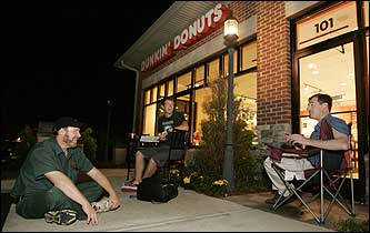 Dan Sullivan, Greg Stafford, and Pete Wade wait for Dunkin' Donuts to open