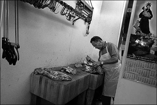 THE NORTH END -- Gino D'Amato has been hand cutting veal roasts and other meat at Sulmona Meat Market for the past 35 years. Like the owners of this 40-year-old market, he is from the Italian town of Sulmona. 'There aren't many of us left,'' says Frank Susi, whose father owns the shop. 'There used to be about 20 meat markets here, now it's down to two or three.' The most popular items at Sulmona's are homemade sausage and veal. Older customers -- the ones who want to see the meat they are buying and have it cut just so -- are dying off, says Susi. Their children are content to go to supermarkets. (Globe Staff Photo / Suzanne Kreiter) audio: Click the play button below to hear Frank Susi and his father, Sulmona owner Domenico Susi, describe their business <object classid='clsid:02BF25D5-8C17-4B23-BC80-D3488ABDDC6B' width='200' height='30' codebase= 'http://www.apple.com/qtactivex/qtplugin.cab'> (Audio by Scott LaPierre, Boston.com)