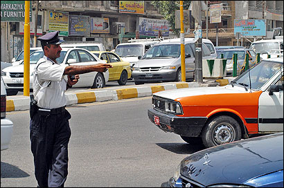 Even during the Saddam Hussein years, the traffic officers in Baghdad had a reputation for integrity. ''The traffic law is the only thing . . . that functions correctly,'' one Iraqi said.