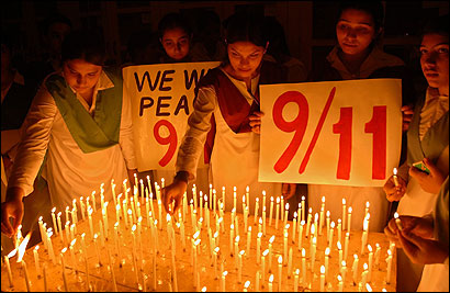 Pakistani students lit candles yesterday in Multan during a ceremony commemorating the fifth anniversary of the Sept. 11 attacks on the United States. Support for Americans was tempered by skepticism over the US-led war on terrorism.