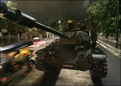 Military tanks surrounded the streets of Government House in Bangkok yesterday as the Thai Army took control of the city.