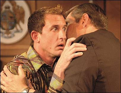 Timothy Babcock as Bernard (left), with his lover, the Prosecutor (Stephen Russell, right).