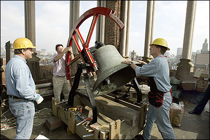 Old South Church members and volunteers helped hoist and place a newly built, 220-pound bell wheel in the Boston church's tower Tuesday.