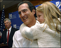 Craig C. Mello with daughter Victoria yesterday. UMass president Jack Wilson was at rear.
