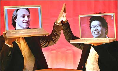 In this file photo from March 29, 2006, YouTube cofounders Chad Hurley, 29, left, and Steven Chen, 27, pose with their laptops at their office loft in San Mateo, Calif. (AP Photo/Tony Avelar, File)