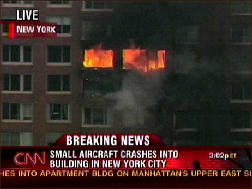 This image from television shows fire and smoke after a small aircraft crashed into the 20th floor of a high-rise on at E. 72nd St. and York Ave. in New York City earlier this afternoon. At least two people are reportedly dead and there was no word yet on injuries linked to the crash on an overcast day.