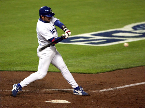 Nomar went 2 for 9 in the NLDS with a double and two RBIs before tearing his right quadricep muscle and sitting out the remainder of the series.