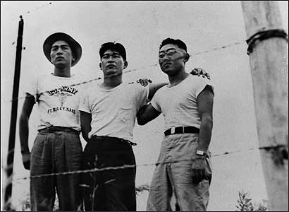 The US has often compromised civil liberties, but scholars disagree about how today's debate fits the historical patterns. Above, Japanese-Americans at an internment camp during World War II.