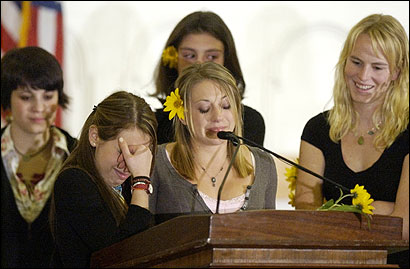 University of Vermont students Fay Oppenheimer (front left) and Erin Degraw (front right) shared memories of their friend Michelle Gardner-Quinn during a memorial service yesterday.