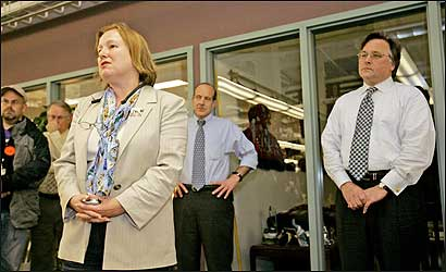 Amanda Bennett, editor of the struggling Philadelphia Inquirer, tells the newsroom on Nov. 8 that she will step down at the end of the year. Her successor, former city editor Bill Marimow (center rear), and Brian Tierney (right), CEO of Philadelphia Media Holdings, look on.
