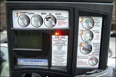 New parking meter on Newbury St. is revealed from covering, Wednesday, October 12, 2006.