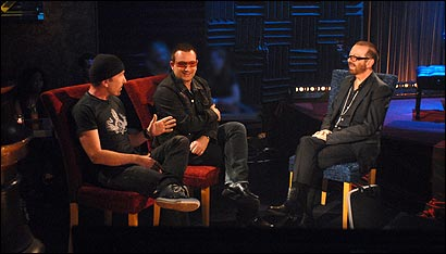 For the ''Off the Record'' debut, Eurythmic-turned-talk show host Dave Stewart (right) interviews U2's the Edge and Bono.