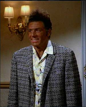 "GUESS WHO'S COMING TO DINNER? Michael Richards as Kramer in an episode of ""Seinfeld."" Trying to impress his girlfriend's family (who happen to be black), Kramer goes to a tanning salon and falls asleep on the tanning bed."