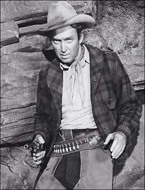 Jimmy Stewart as a bounty hunter trembling on the brink of collapse in 'The Naked Spur.'