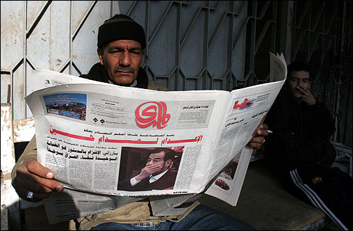 An Iraqi read a newspaper dedicated to the news of Saddam Hussein's death sentence appeal rejection in Baghdad on Wednesday.