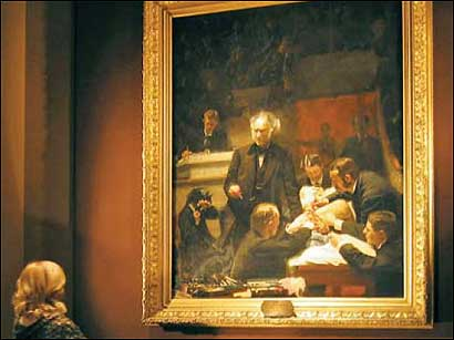 """""""The Gross Clinic,"""" by Thomas Eakins, hanging in a gallery at Thomas Jefferson University in Philadelphia. The painting depicts a lecture and demonstration by noted 19th-century surgeon Dr. Samuel D. Gross."""