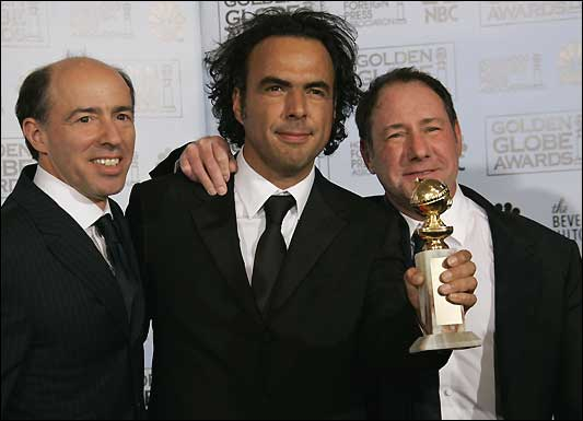 Director Alejandro Inarritu (center) poses with producers John Kilik (left) and Steve Golin