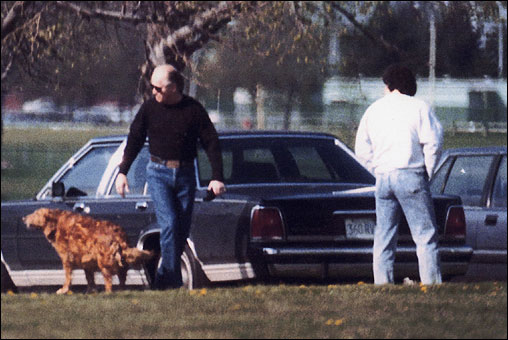 Another shot of Bulger and Weeks, this time joined by a dog at Columbia Park in South Boston.