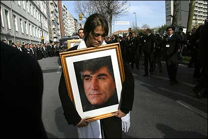 Sera Dink, daughter of the Armenian-Turkish editor Hrant Dink, carries a portrait of her father as she leads his funeral procession on Tuesday.
