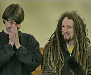 Sean Stevens (left) and Peter Berdovsky found something amusing during their arraignment inside Charlestown District Court.