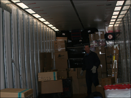A mover ensured the minor leaguers' gear was packed tight to make sure there was room for everything.
