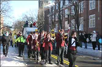 Harvard marching band drum major Kristen Rose, a Harvard Jr., leads the parade