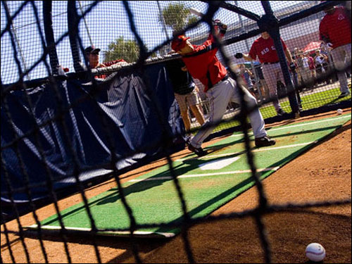 Sox second baseman Dustin Pedroia takes some swings in the batting cage on Tuesday.