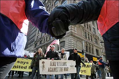 Demonstrators held hands as members of Iraq Veterans Against the War participated in an antiwar march yesterday in Manhattan. This week, the House plans to vote on a spending bill that would set a US troop withdrawal deadline of Sept. 1, 2008.