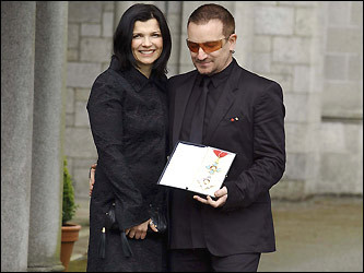 Bono, birth name Paul Hewson, poses with his wife, Ali Hewson