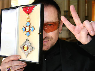 Bono shows off his honorary knighthood