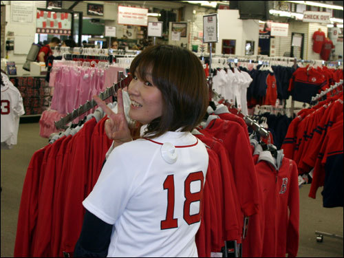 Kumi Sakurai, who flew into Boston from Japan to attend Tuesday's game, tried on a Matsuzaka jersey at the Red Sox team store across from Fenway.