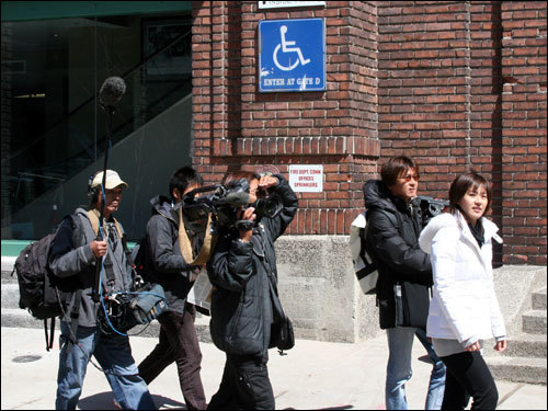 A Japanese media contingent was on the prowl for news outside Fenway as the action started to pick up Wednesday afternoon.