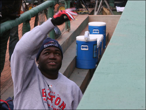 Big Papi stopped briefly on the dugout steps to toss a baseball to a fan in the crowd.