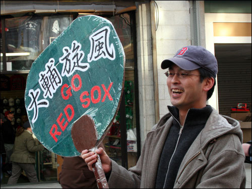 The signs came in all shapes and sizes -- and two languages -- as the crowd came out to cheer on Dice-K in his Fenway Park debut.