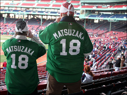 Jim McSorley, of Charlestown, and his son Colin scored their tickets online and found the rare green Red Sox Matsuzaka jersey at a local retailer. The Sox will wear green jerseys and caps during Thursday's game against the Mariners to honor Celtics legend Red Auerbach, who died on Oct. 28, 2006, at age 89.