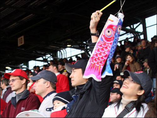 Another original item making its debut at Fenway on Wednesday night was the not-exactly-ubiquitous fish flag on a stick.