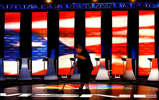 A worker swept the stage April 26 at South Carolina State University prior to the first presidential debate for the 2008 election. The debate, featuring eight Democratic presidential candidates, took place 263 days before the first ballot will be cast in the Iowa caucus next January.
