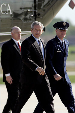 President Bush vetoed the war bill Tuesday, the four-year anniversary of his 'mission accomplished' declaration aboard the USS Abraham Lincoln. The president's veto came as no surprise, and although he said he hopes to reach a compromise with Democrats, he said he won't support an Iraq timetable. At left, President Bush headed toward Air Force One at Andrews Air Force Base in Maryland for a trip to Florida.