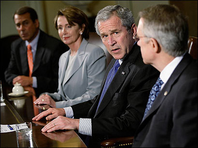 President Bush, shown with House minority leader John Boehner (left), Speaker Nancy Pelosi, and Senate majority leader Harry Reid, called for a new plan to fund the Iraq war yesterday after the House failed to override his veto of a bill requiring a troop pullout. Democrats agreed to drop a demand for a timeline.