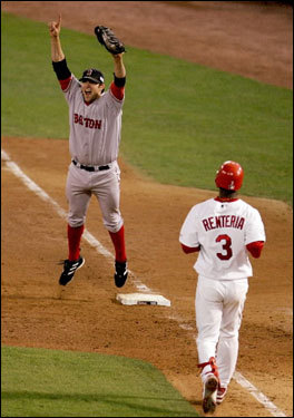 In this Oct. 27, 2004 photo, first baseman Doug Mientkiewicz, who came to the Sox in a deadline trade from the Twins in 2004, celebrates the final out as the Red Sox defeated the St. Louis Cardinals 3-0 in Game 4 of the World Series at Busch Stadium in St. Louis. Mientkiewicz pocketed the ball he caught for the final out and then loaned it back to the Red Sox for their World Series trophy tour.
