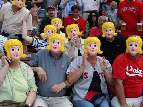 Wakefield's Jake Hubbard, Carol Nicastro, Jim Phipps, Jacqui Phipps, and friends wore these blond-haired little princess masks to get the attention of Alex Rodriguez before the start of the game.