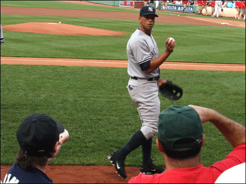 A-Rod could not resist taking a peek at The Blondies as he warmed up in foul territory before the start of the game.