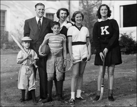 Mitt Romney held the bat in a photo for a family Christmas card.
