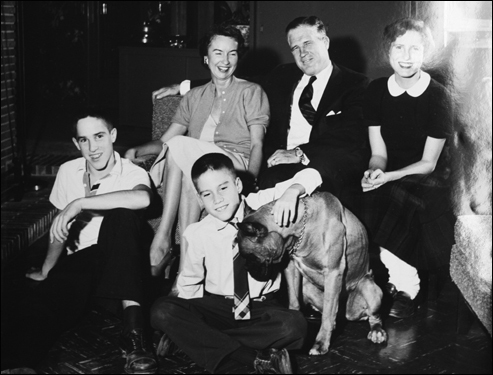 Members of the Romney family in their home on Vaughan Road in Bloomfield Hills, Mich. Mitt is the youngest boy in the center, and he was petting the family dog, Bosco.
