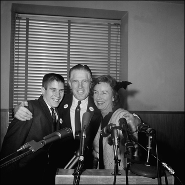 George Romney hugged his wife, Lenore, and son Mitt, 14, at a Detroit news conference Feb. 10, 1962, after he announced he would seek the Republican nomination for governor of Michigan.