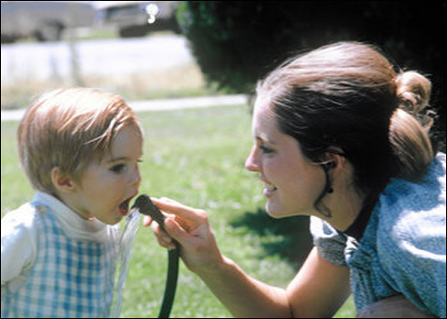 Ann Romney played with her son Tagg in 1971.